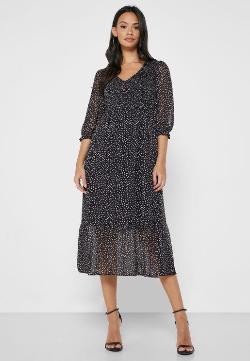 فستان مطبع بأكمام منفوشة