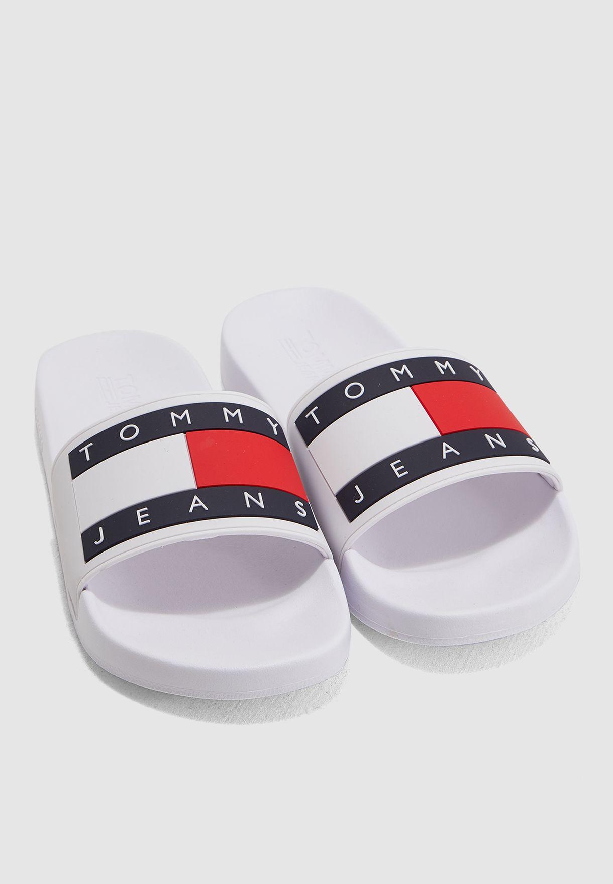 cfd0cd98b Shop Tommy Hilfiger white Logo Flag Pool Slides EM0EM00284100 for ...