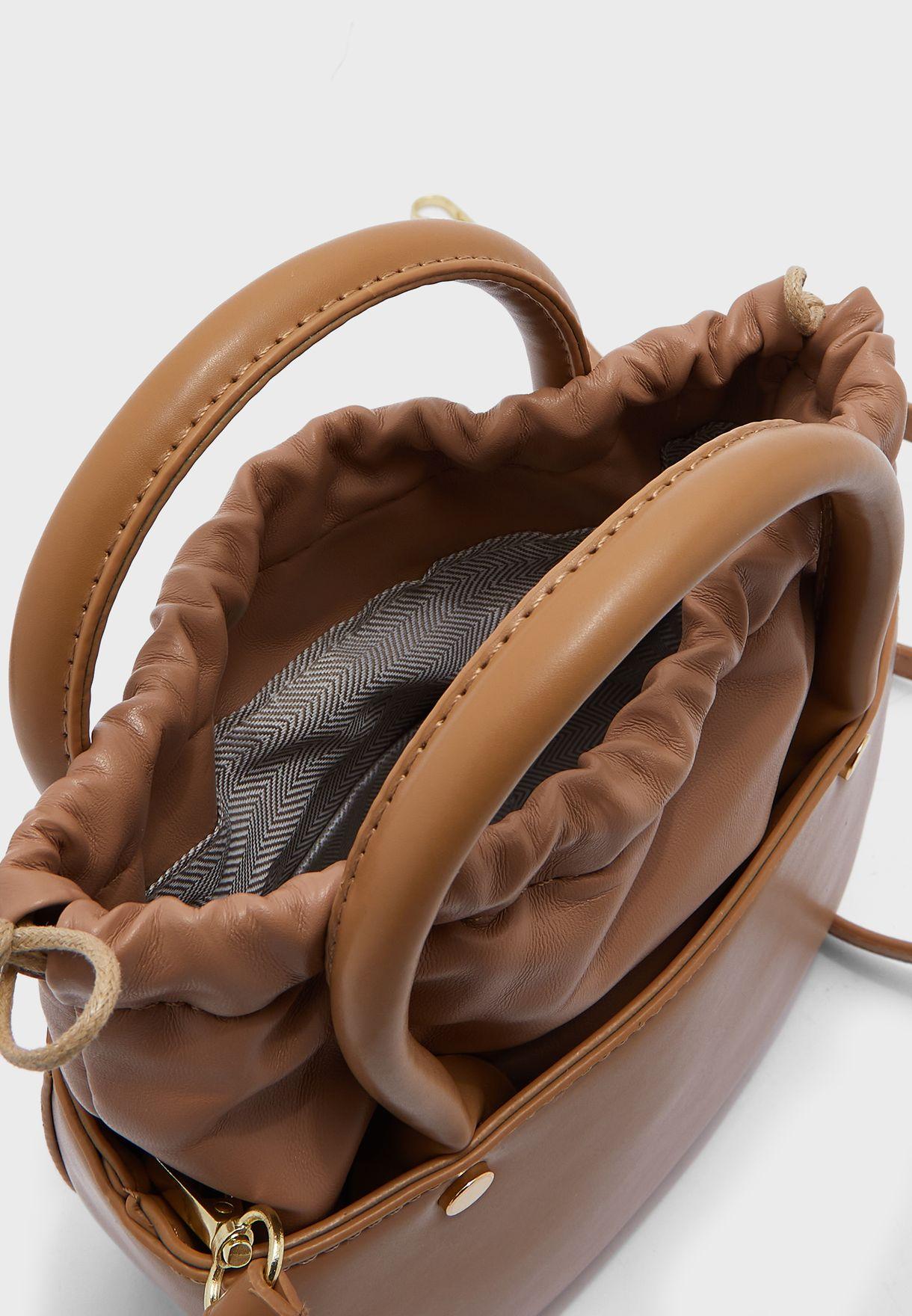 شنطة مع حقيبة داخلية بأربطة
