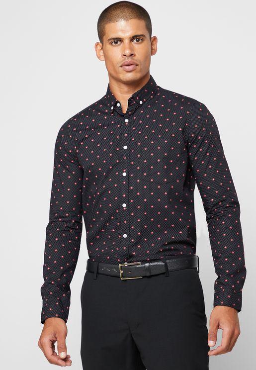 قميص منقط بطبعات ازهار