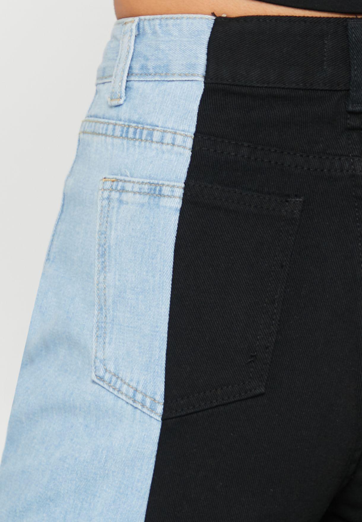 بنطال جينز بنمط كتل الالوان