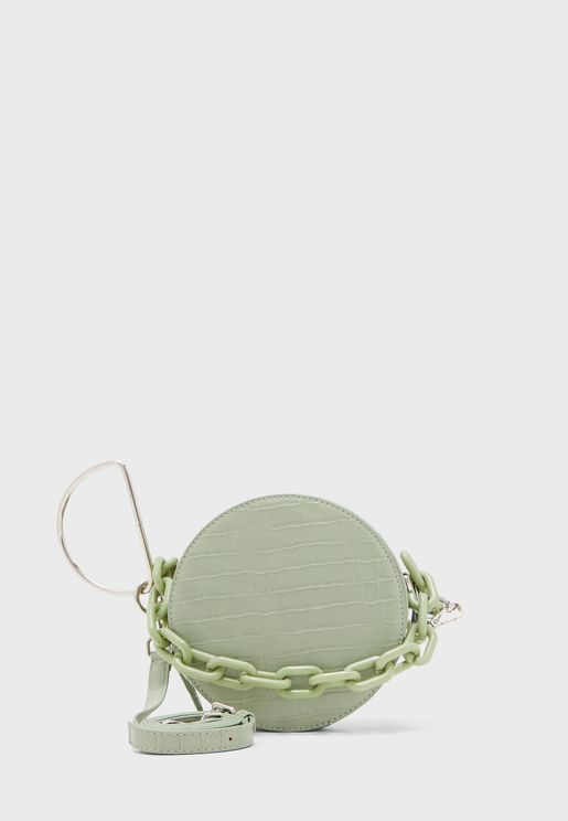 شنطة دائرية بنمط جلد تمساح