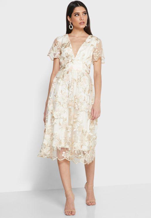 فستان بازهار مطرزة ومزين بالترتر