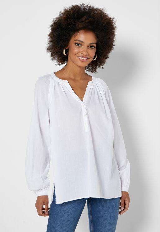 قميص مزين بتطريزة من الخلف