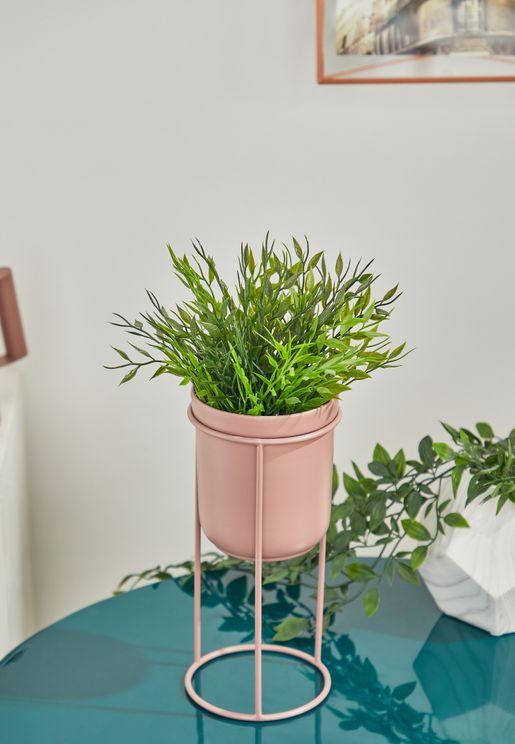وعاء نباتات على حمالة