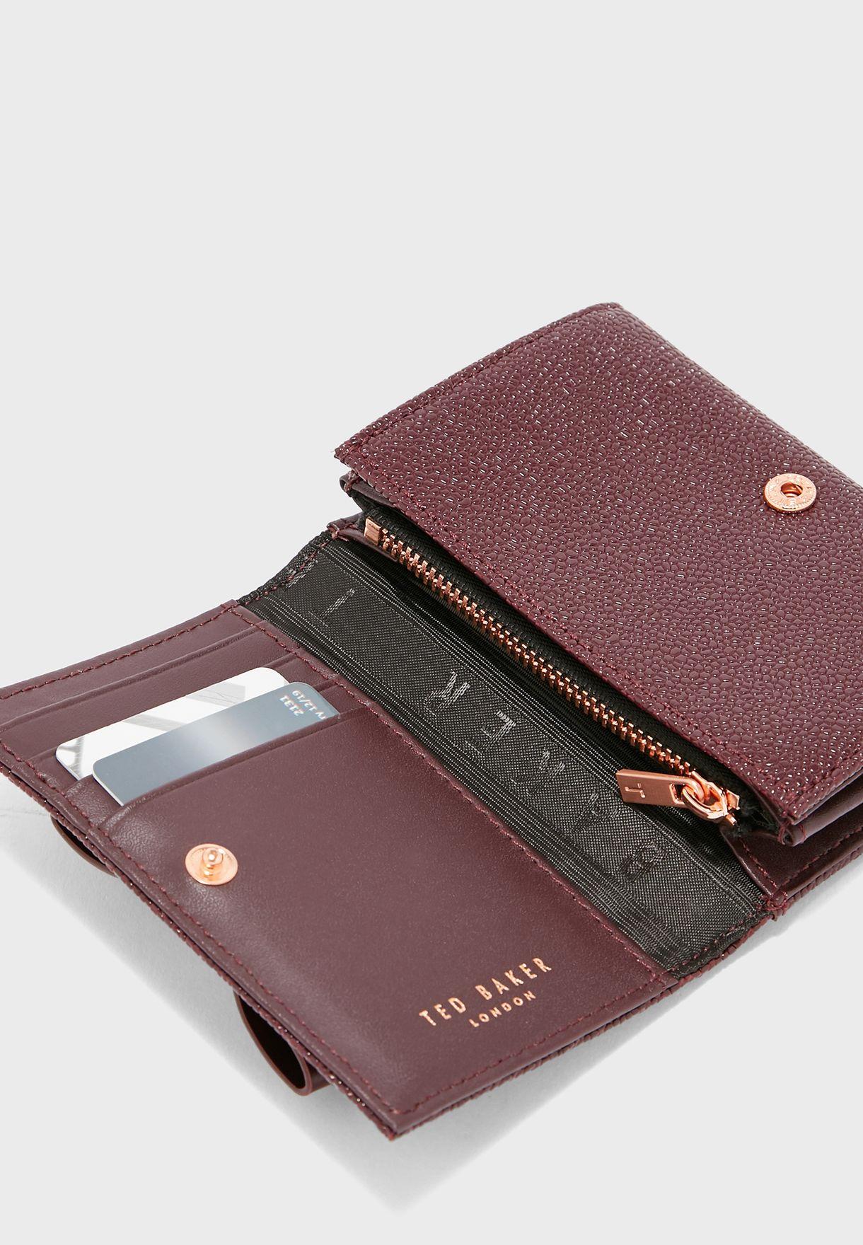محفظة صغيرة من الجلد الاصلي
