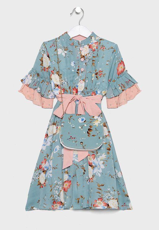 فستان بطبعات ازهار مزين باللؤلؤ