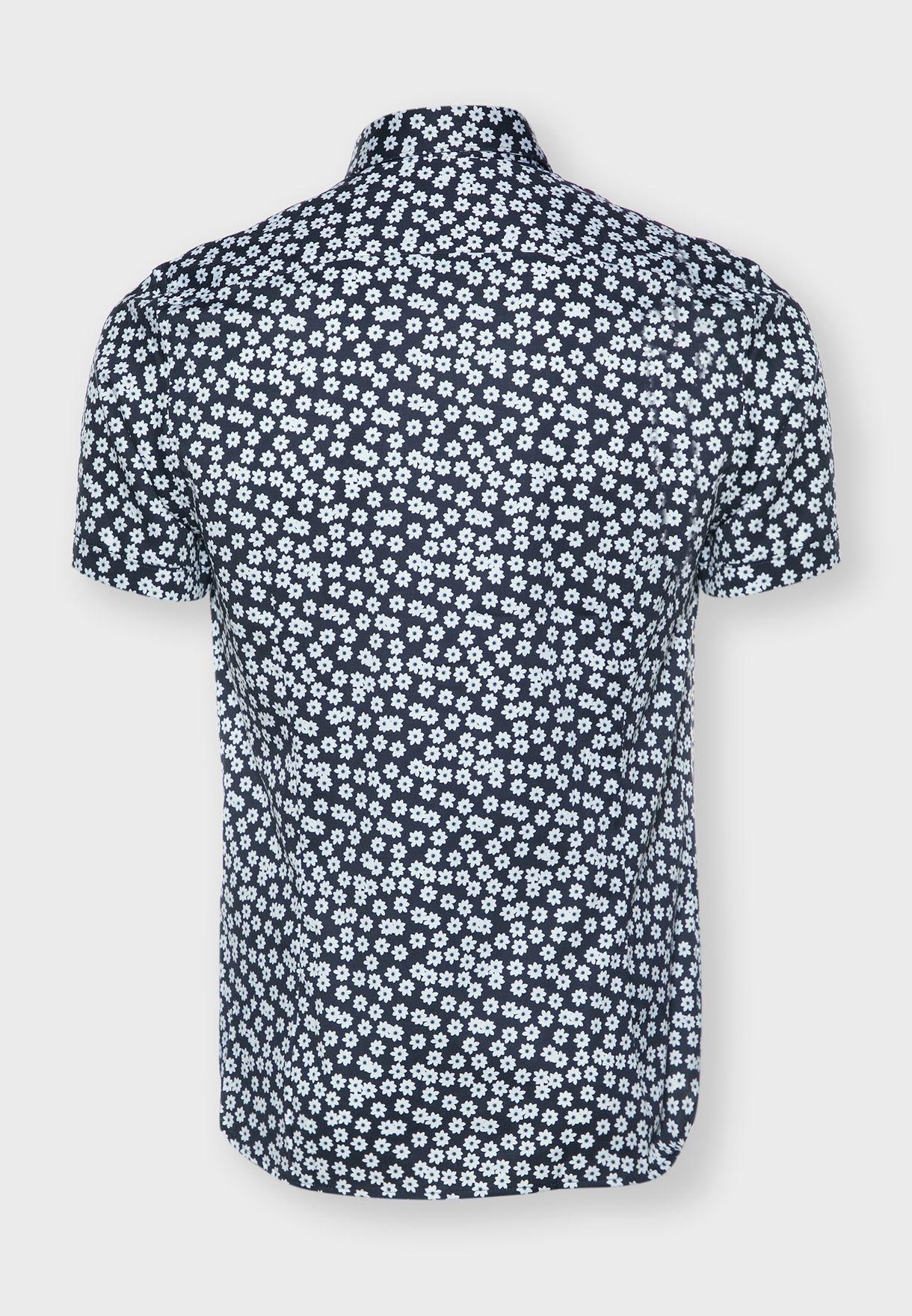 قميص بطبعات اوراق ازهار