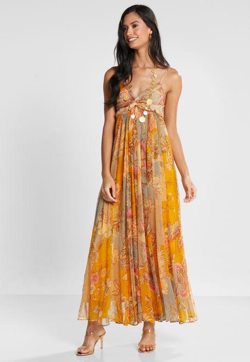 فستان بطبعات وعقدة في الامام