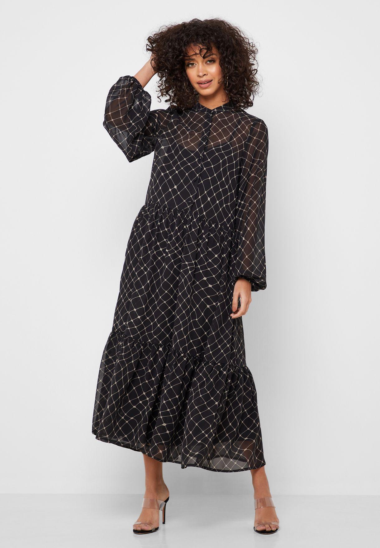 فستان مطبع وبحافة كشكش