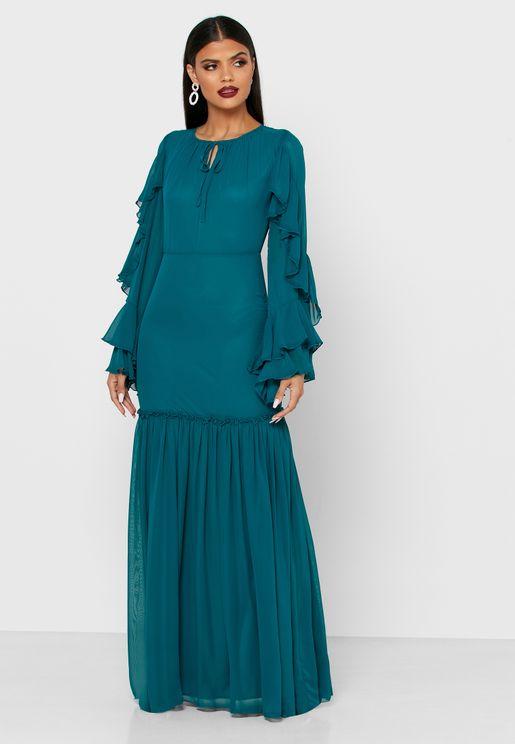 فستان باكمام شفافة وطبقات كشكش