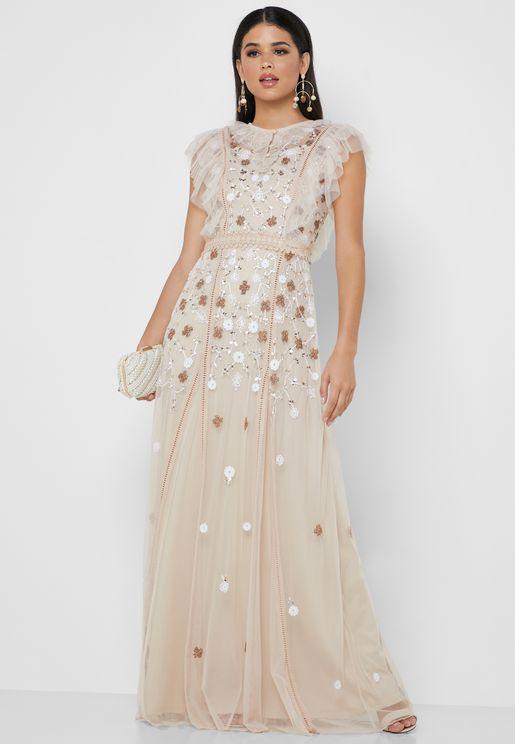 فستان شفاف مطرز بالخرز والترتر