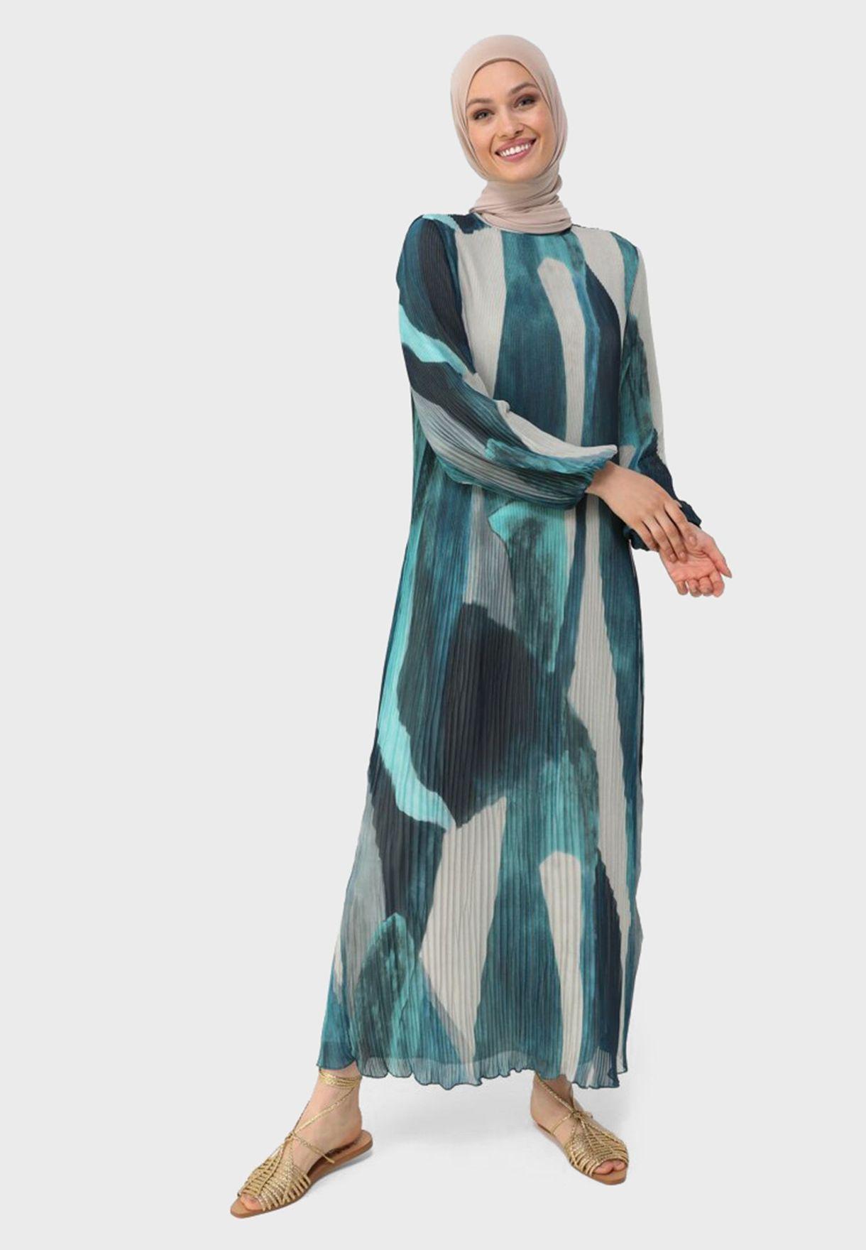فستان بطبعات وياقة دائرية
