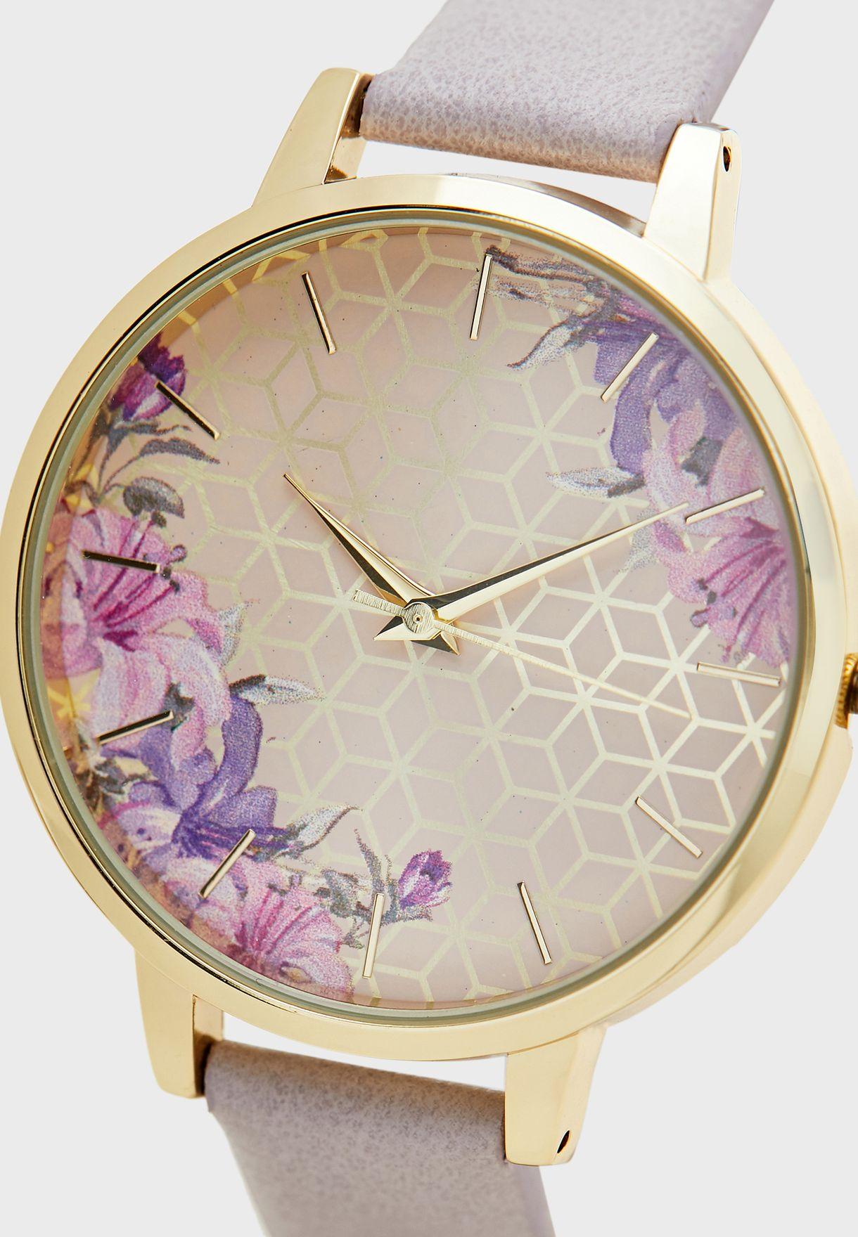 ساعة بطبعات ازهار