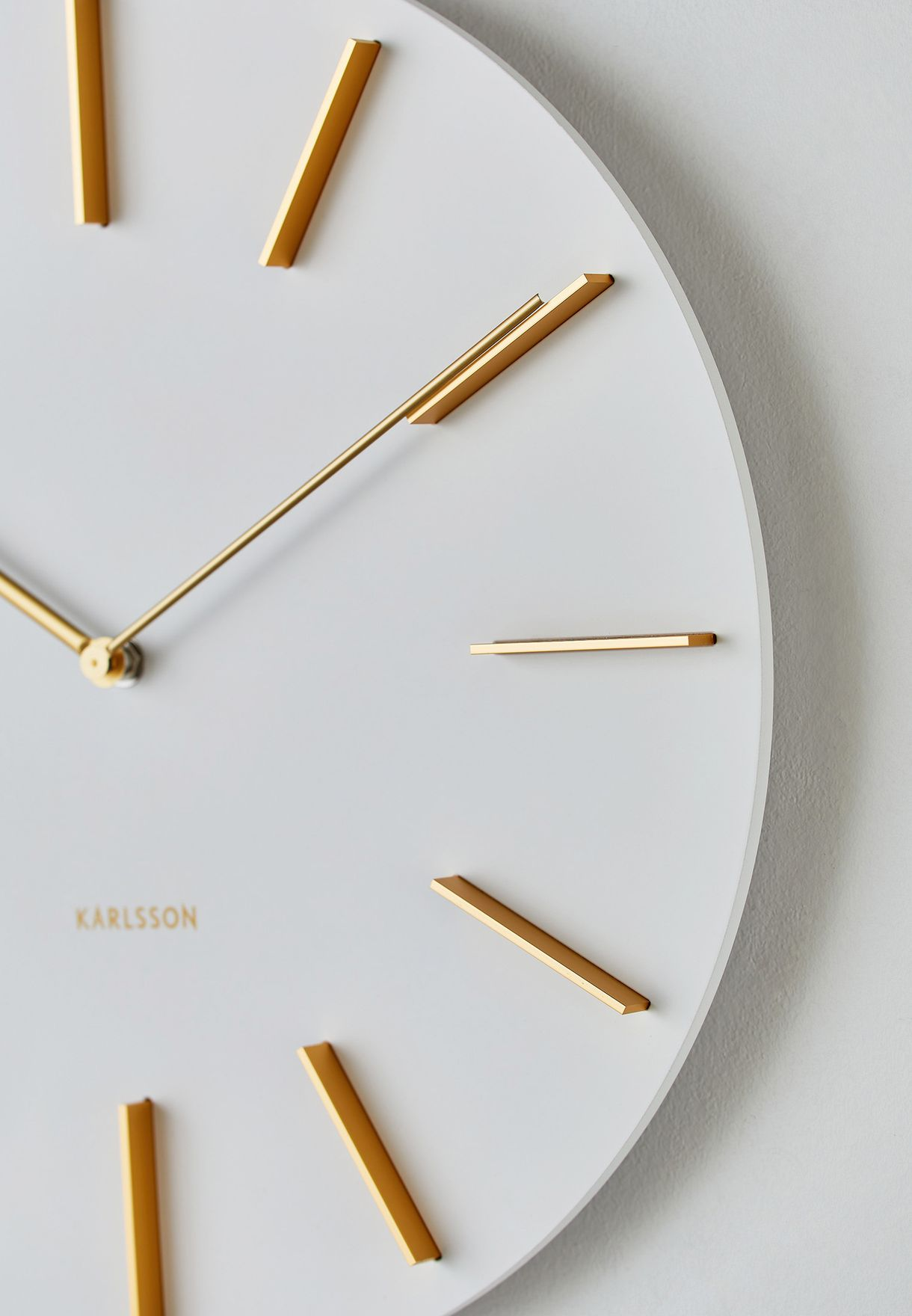 Discreet White and Gold Wall Clock