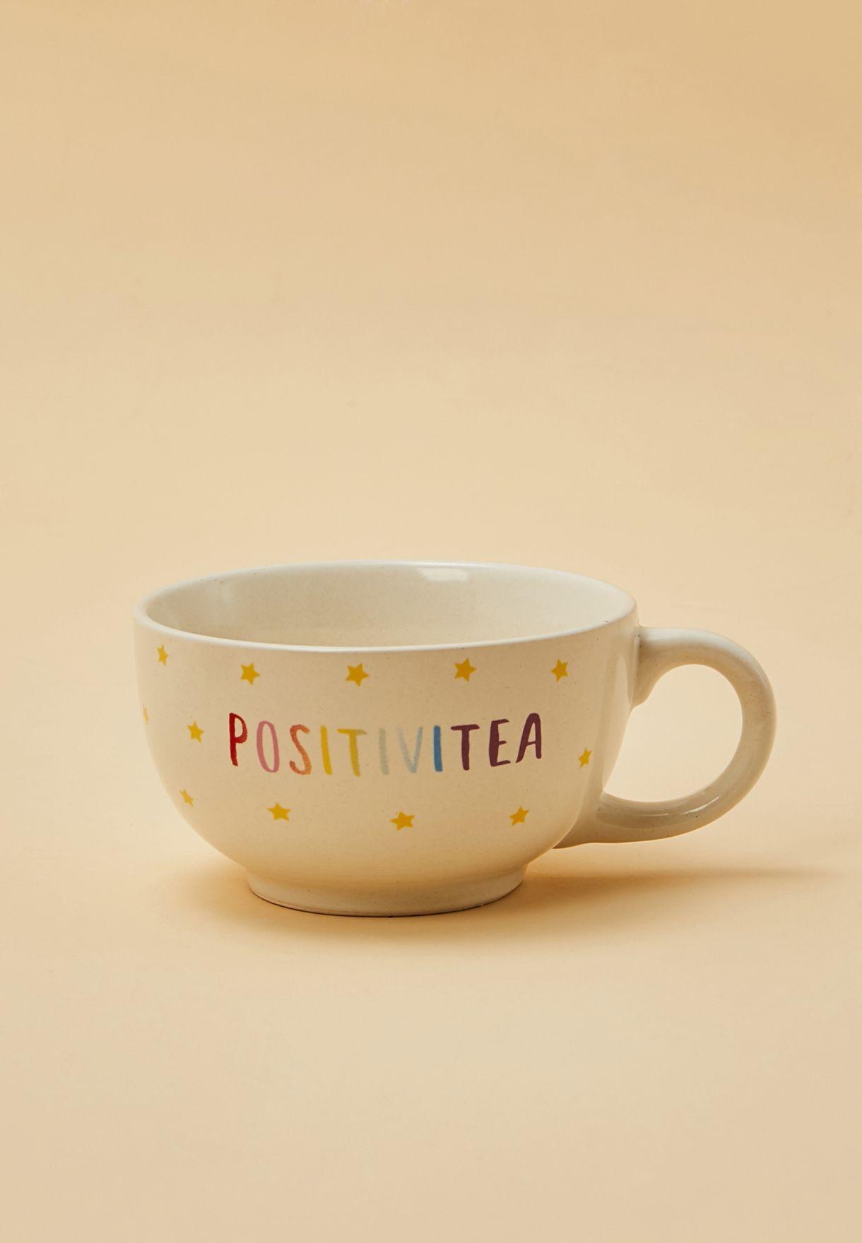 طقم من ابريق شاي وفنجان