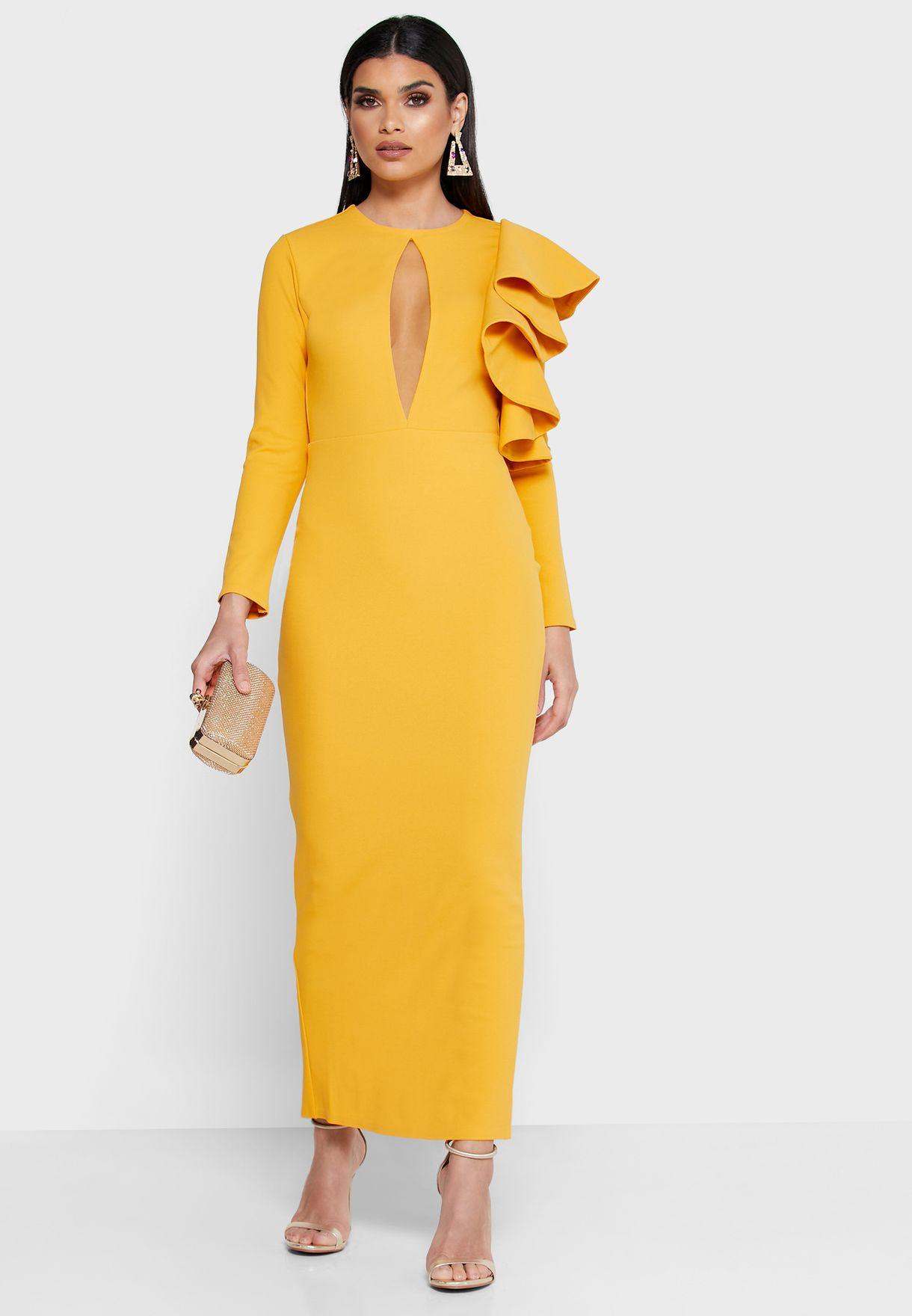 فستان بأزرار في الخلف مع كشكش على الكتف