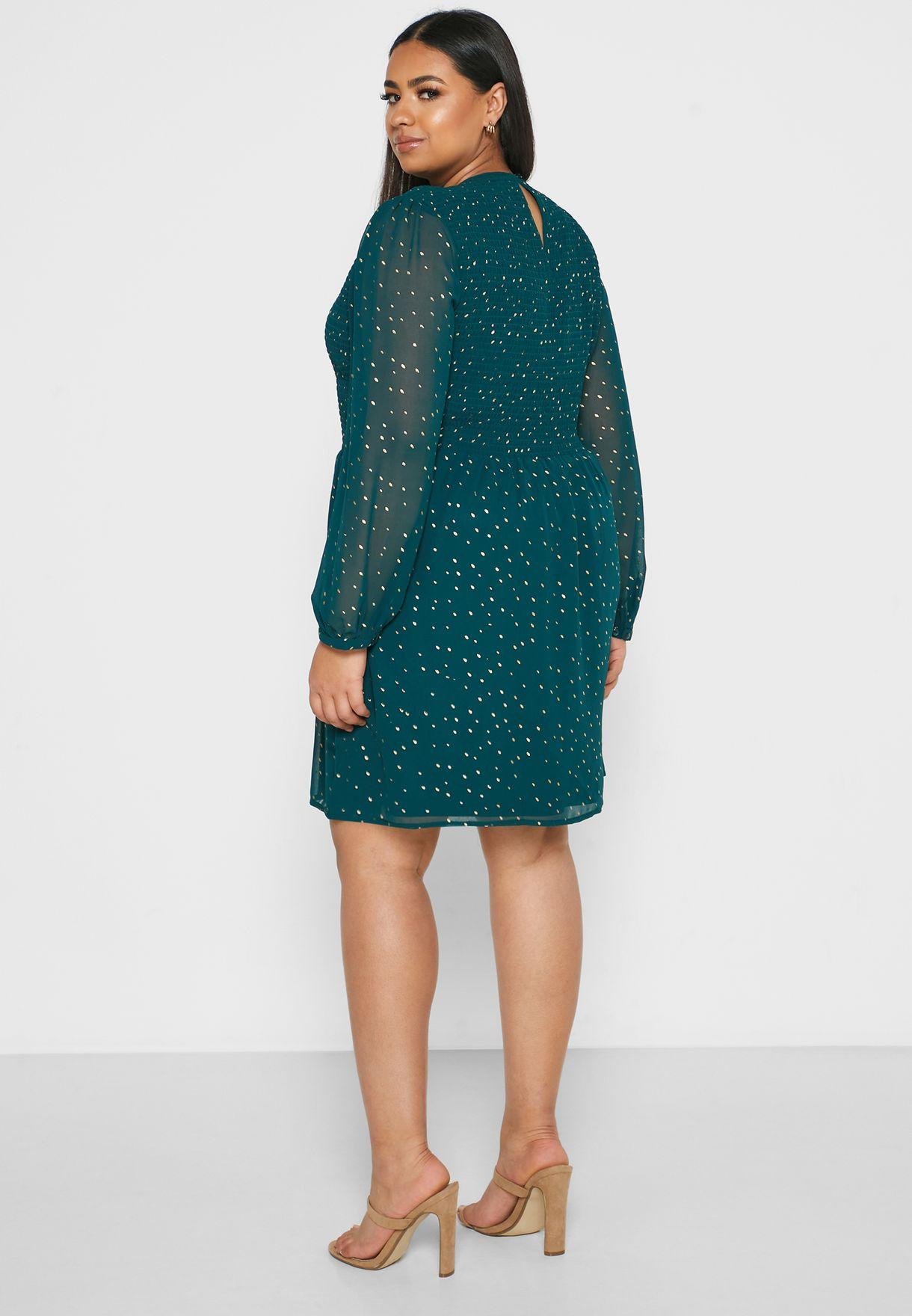 فستان مطبع باكمام شفافة
