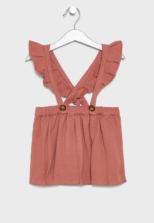 فستان اطفال مزين بالكشكش