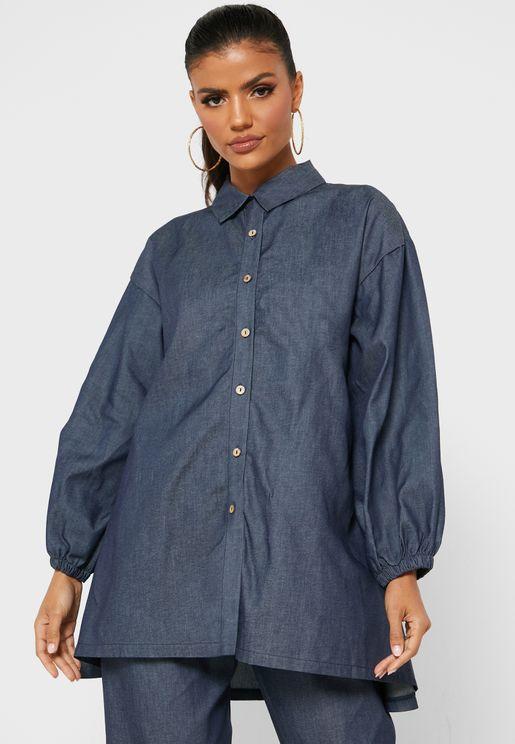 قميص دنيم مزين بعقدة