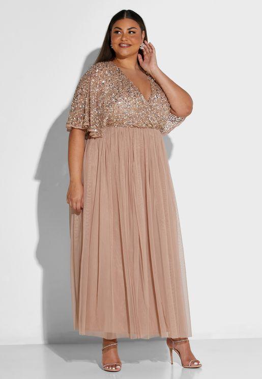 فستان ذو اكمام واسعة مرصع بالترتر