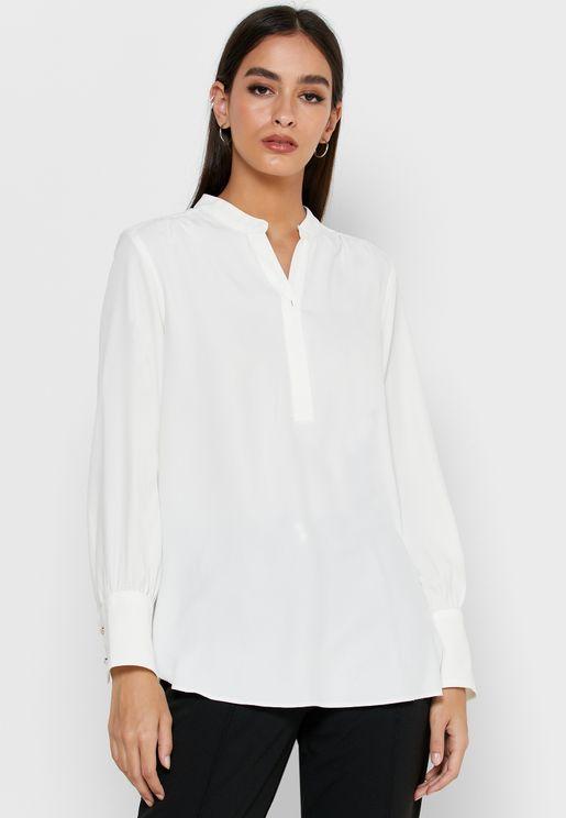 بلوزة بنمط قميص مع حافة متباينة الطول