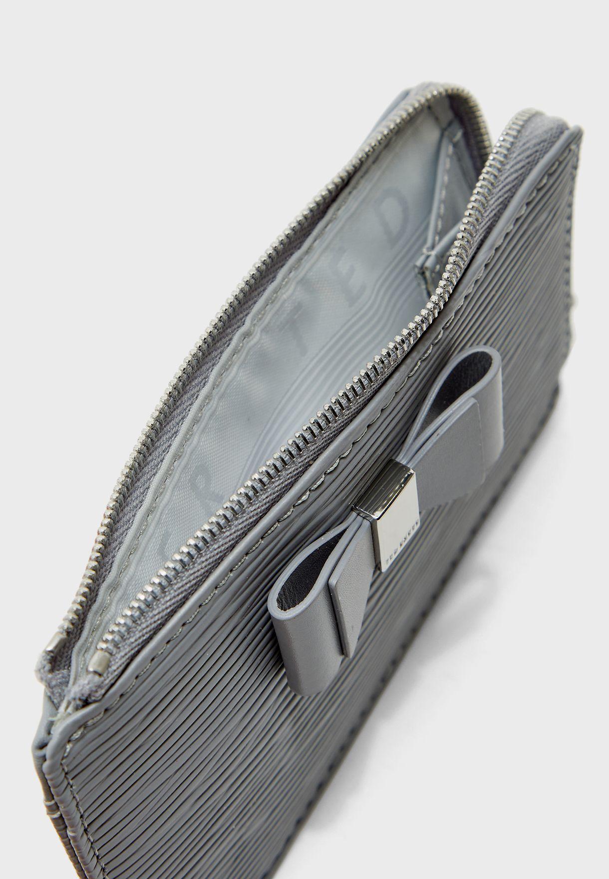 محفظة مزينة بفيونكة