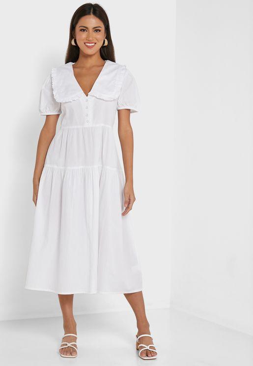 فستان بأكمام منفوشة وطبقات متعددة