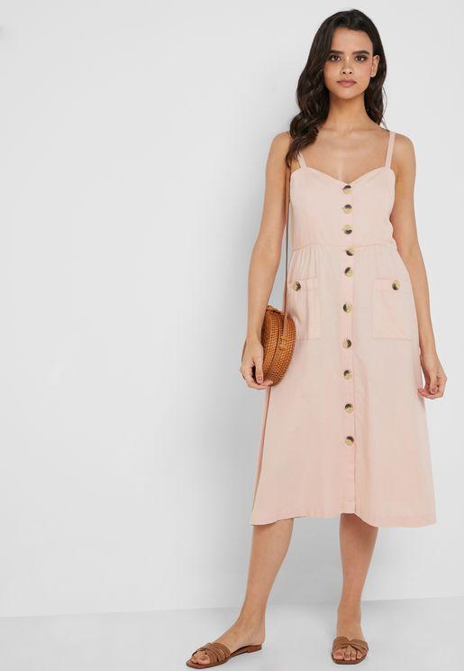 فستان بحمالات وأزرار امامية