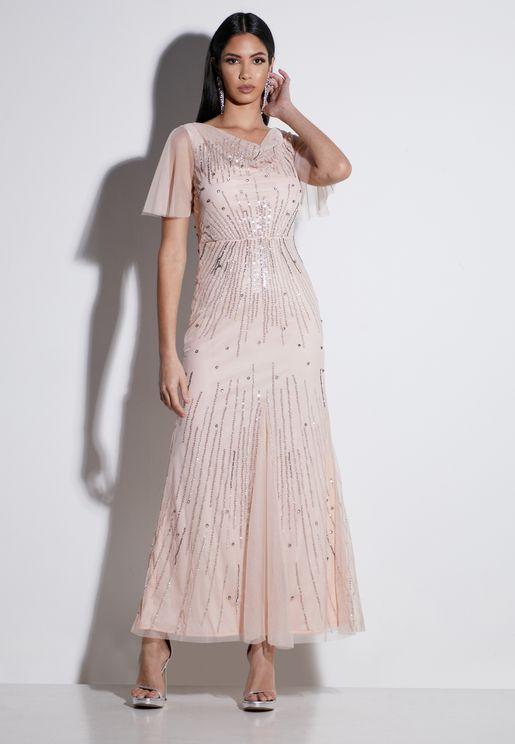 فستان باكمام شفافة ومزين بترتر