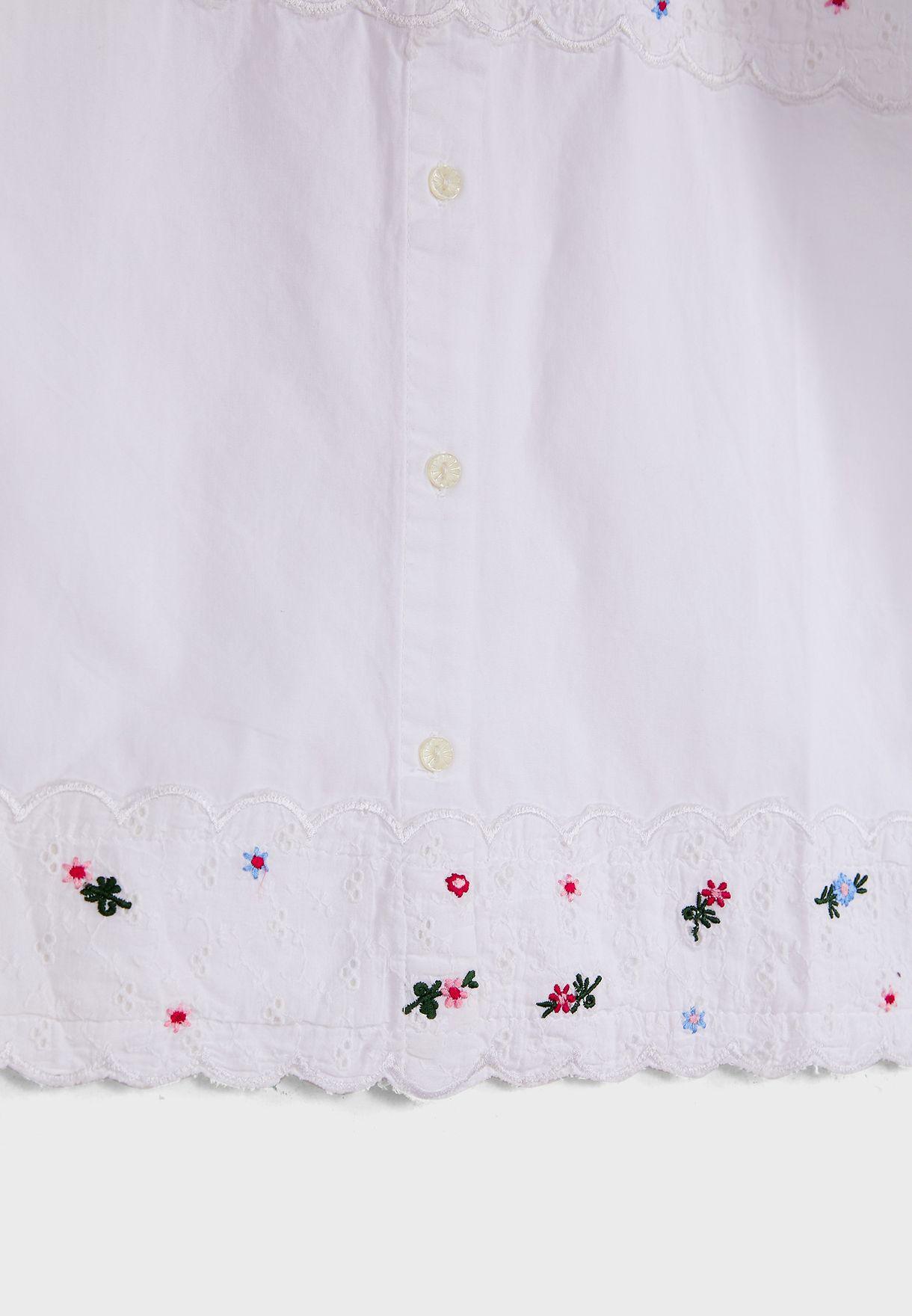 قميص بتطريز وازهار