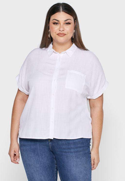قميص بأكمام مطوية