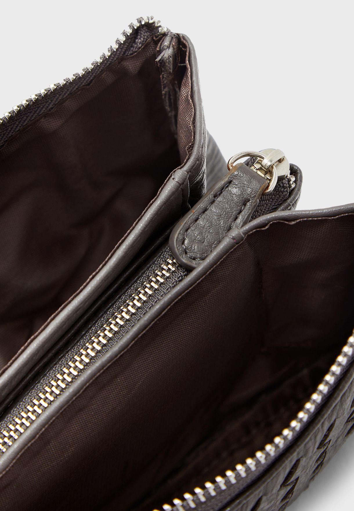 محفظة بحمالة حول الرسغ