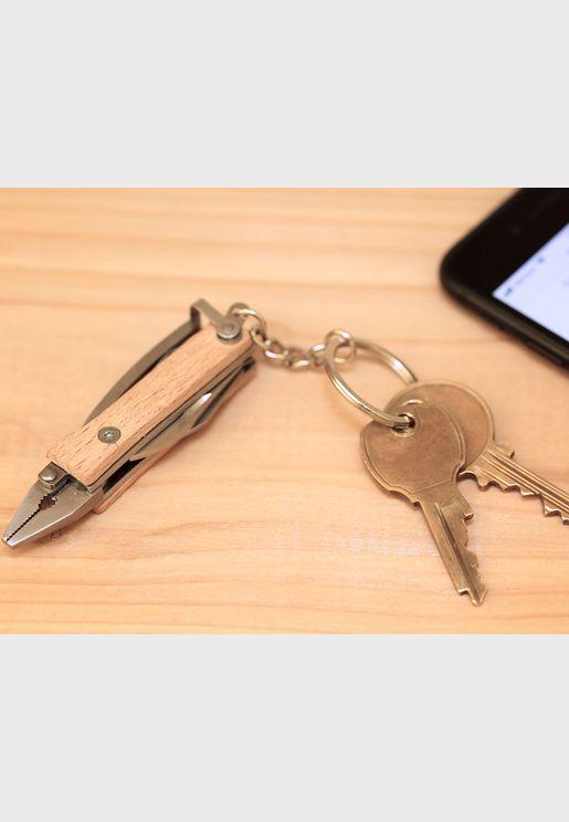 كماشة صغيرة وسلسلة مفاتيح
