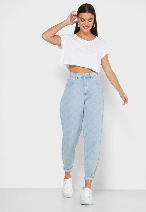 بنطال جينز مزين بدرزات