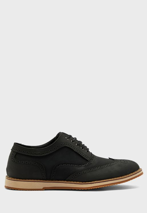 حذاء جلد صناعي بأربطة