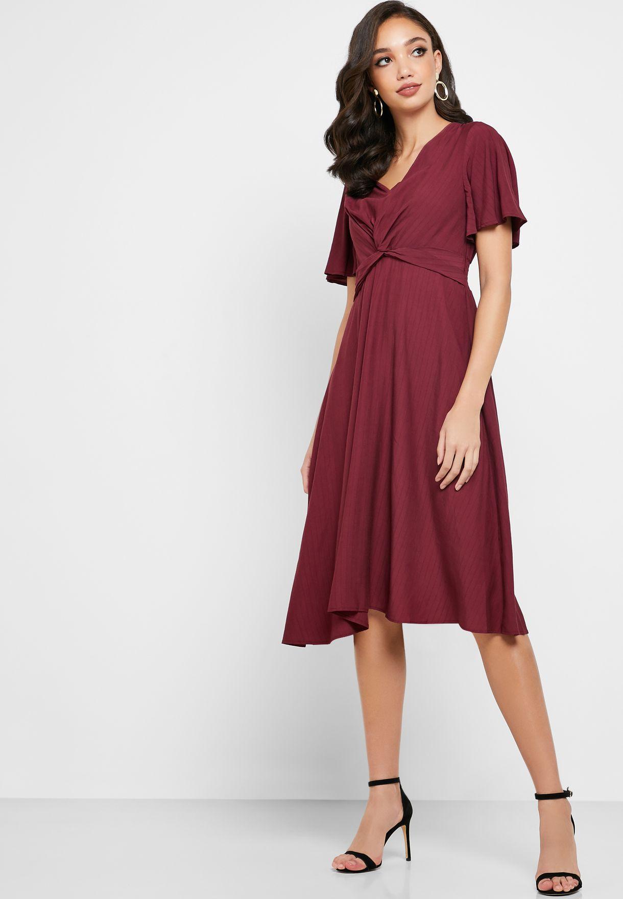 فستان ميدي بعقدة من الامام