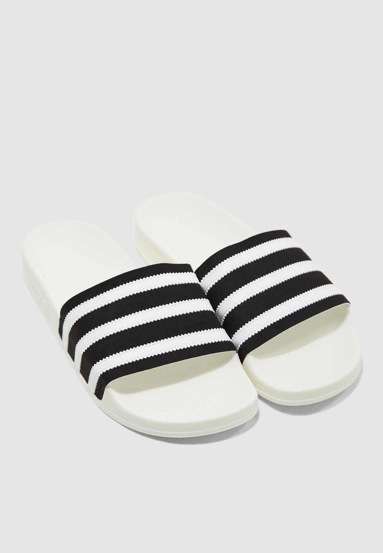 27771987339a Shop adidas Originals white Adilette Slides BD7592 for Men in Oman -  14448SH68UIP