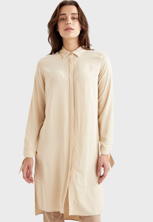 قميص بحواف غير متناظرة