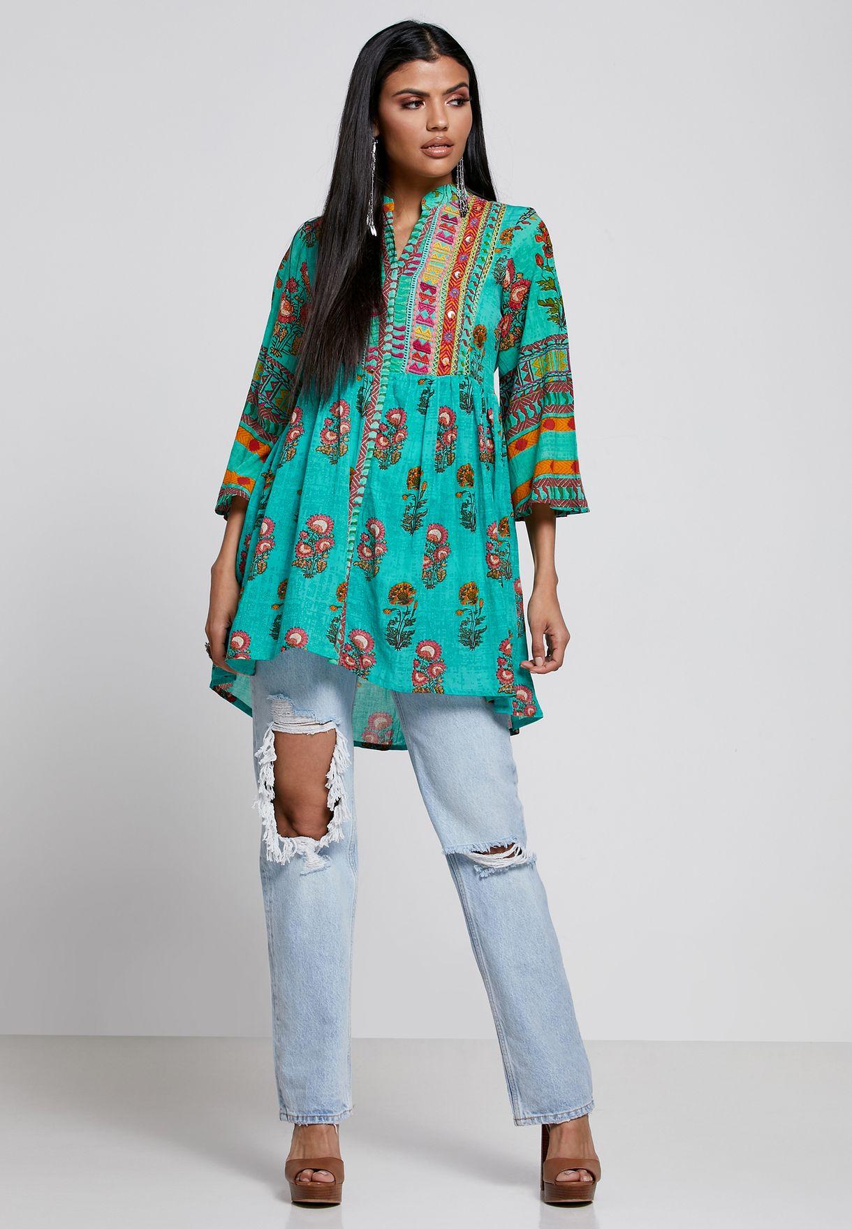 بلوزة بنمط فستان