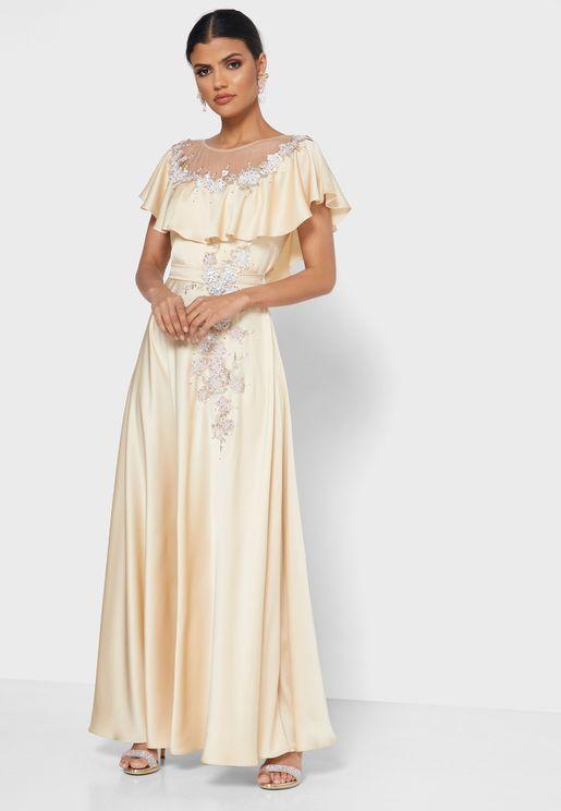 فستان مزين بأزهار ودبابيس