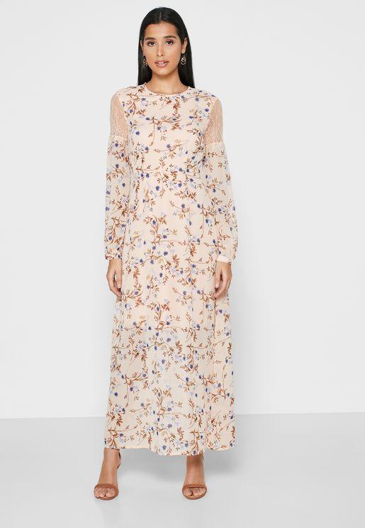 فستان باكمام شفافة وطبعات ورود
