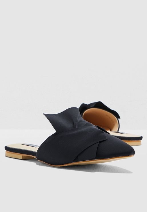 Flat Slip On Mule With Bow Detail