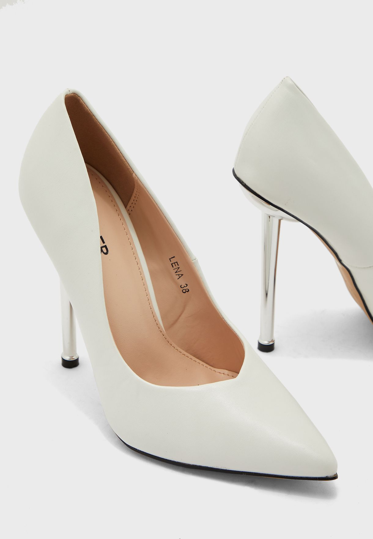 Pointed toe pump with metal heel