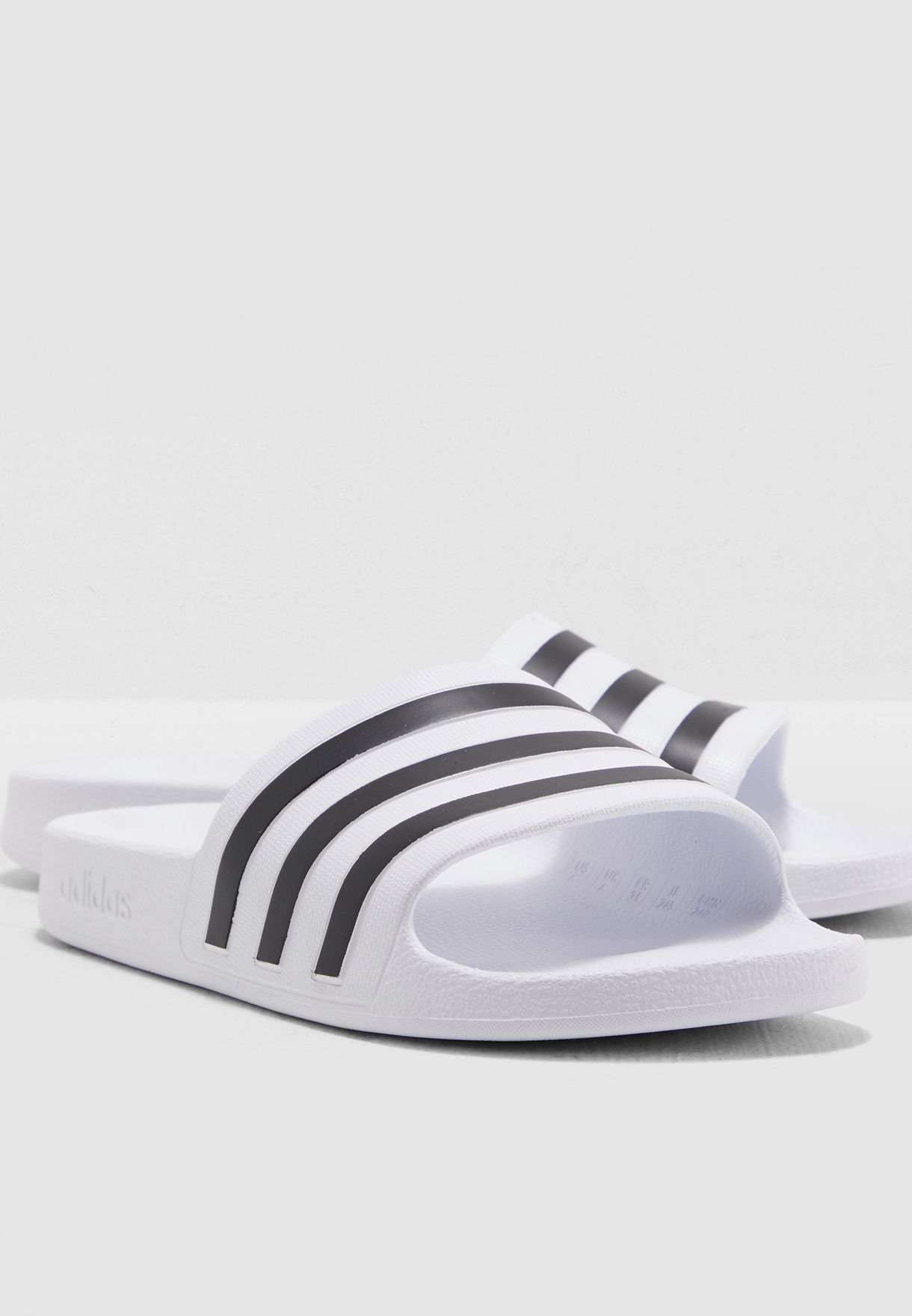 111cf9d1a3821 Shop adidas white Adilette Aqua Slides F35539 for Men in UAE ...