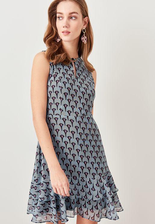 فستان بحواف كشكش وطبعات